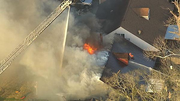 Aerials of firefighters battling major house fire