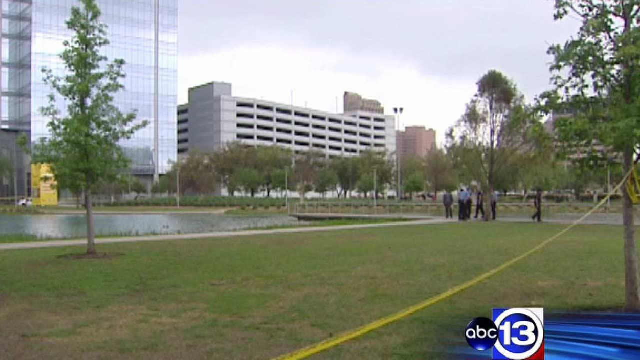 Police surround the Discovery Green pond after a body was pulled from the water on Easter morning