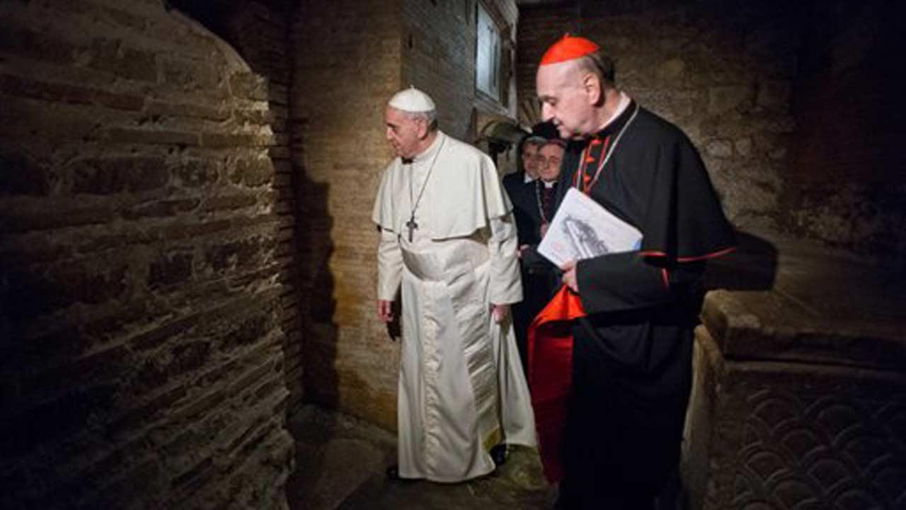 In this picture made available by the Vatican newspaper LOsservatore Romano, Pope Francis, followed by Cardinal Angelo Comastri, right, and Bishop Vittorio Lanzani, partially hidden, visits the necropolis where pagans and early Christians were buried under St. Peters Basilica at the Vatican and where St. Peter is believed to be buried, Monday, April 1, 2013, during what was called the first-ever visit by a pope. The basilica was built over the location where early Christians would gather in secret, at a time of persecution in ancient Rome, to pray at an unmarked tomb believed to be that of Peter, the apostle Jesus chose to lead his church. (AP Photo/LOsservatore Romano)