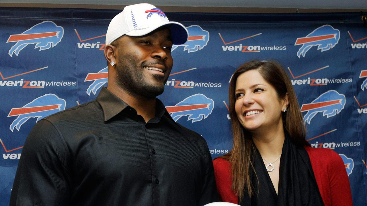 Buffalo Bills Mario Williams poses for a photo with his fiance Erin Marzouki after an NFL football news conference in Orchard Park, N.Y., Thursday, March 15, 2012. Williams signed a contract touted as the richest ever given to an NFL defensive player _ a deal worth up to $100 million with $50 million guaranteed, according to his agent, Ben Dogra. (AP Photo/David Duprey)
