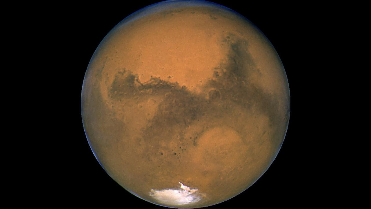 This Aug. 26, 2003 image made available by NASA shows Mars photographed by the Hubble Space Telescope on the planets closest approach to Earth in 60,000 years.  (AP Photo/NASA)
