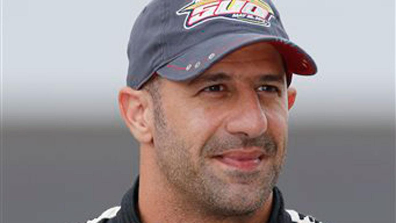 Tony Kanaan, of Brazil, poses after he qualified on the first day of qualifications for the Indianapolis 500 auto race at the Indianapolis Motor Speedway in Indianapolis, Saturday, May 18, 2013. (AP Photo/Dave Parker)