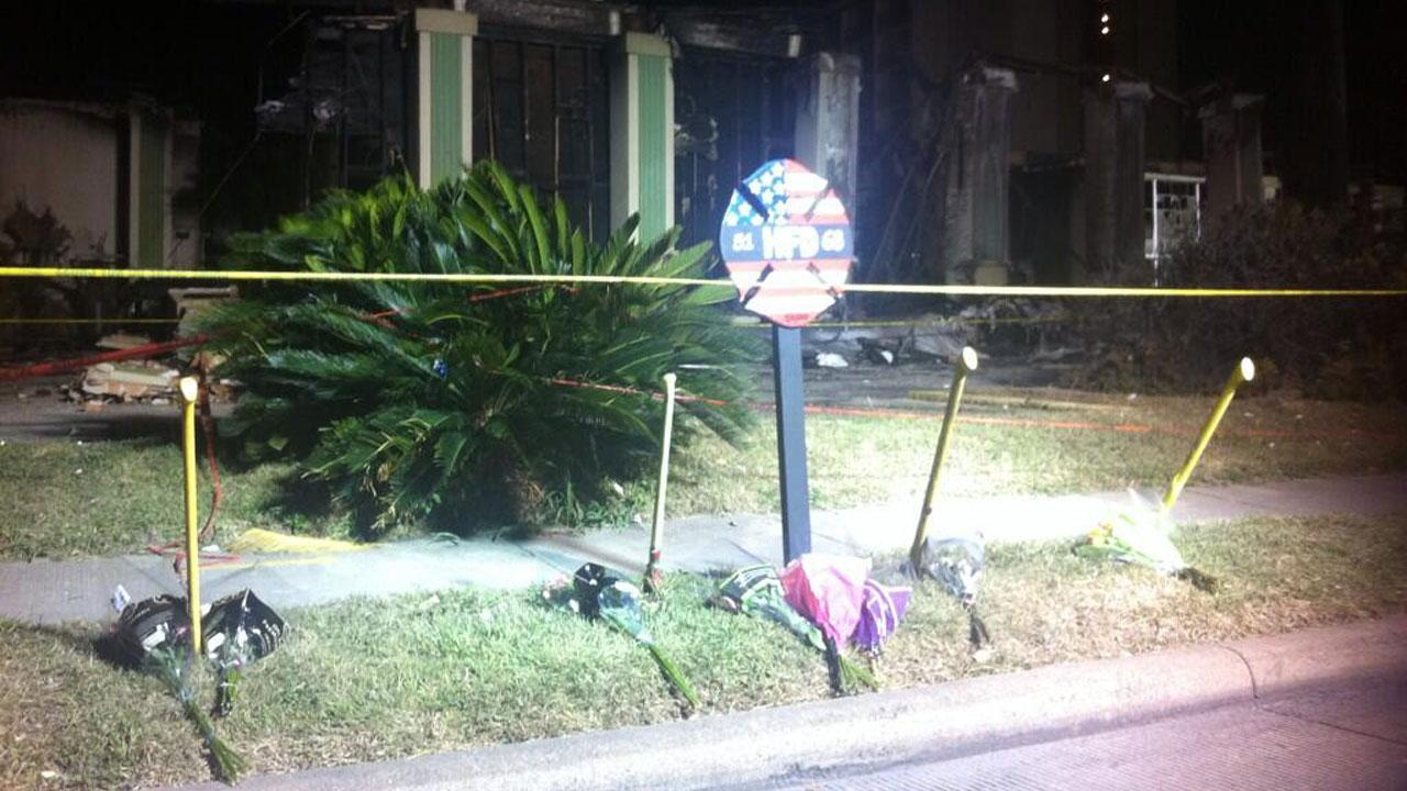 Memorial to fallen firefighters outside Southwest Inn on Saturday night <span class=meta>(Jessica Willey)</span>