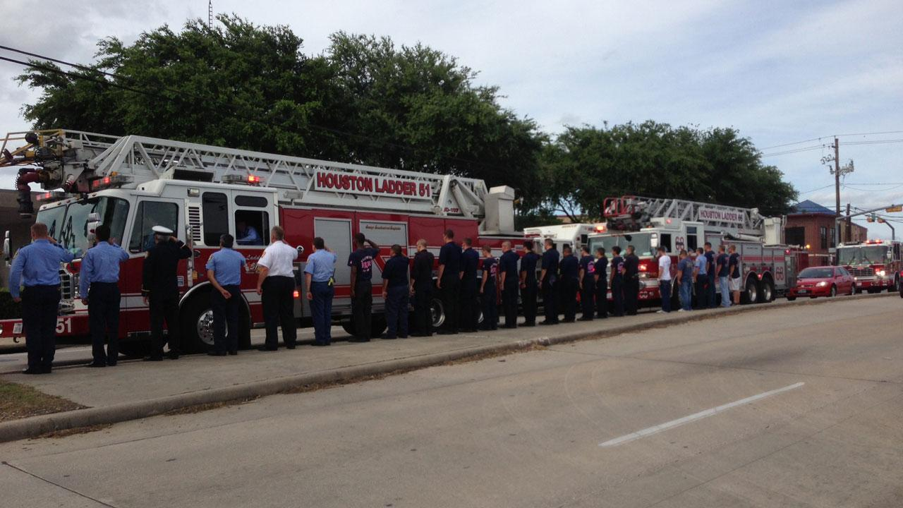 Firefighters formed a Wall of Honor as their fallen comrades were taken in a processional to Houston-area funeral homes <span class=meta>(Miya Shay)</span>