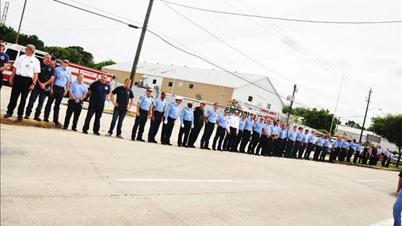 Procession of Fallen Firefighters arriving at Pat H. Foley Funeral Home on Sunday, June 2, 2013. Photo submitted by an ABC13 viewer. Send your photos to news@abc13.com. <span class=meta>(iWitness Reports)</span>