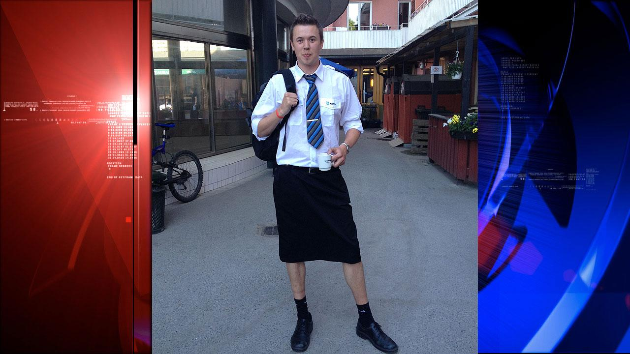 Swedish train driver Martin Akersten poses wearing a skirt