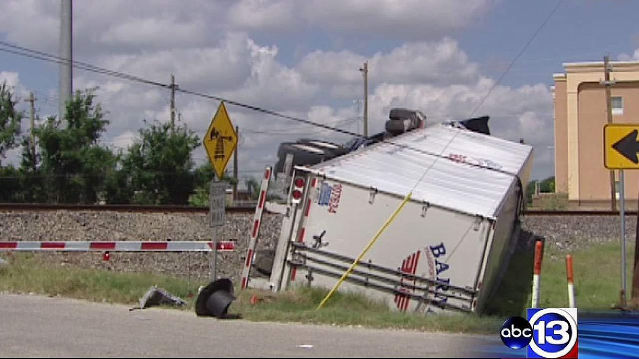 No one was injured when the big rig was struck by a train Monday