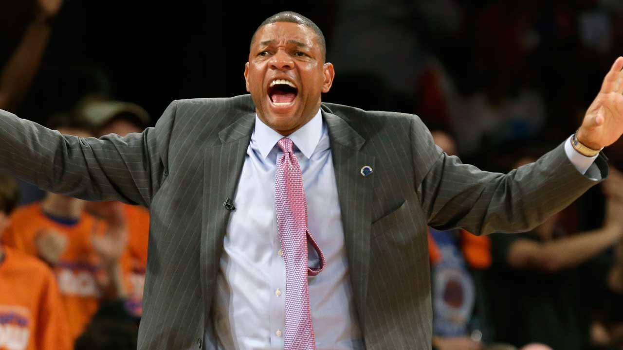 Boston Celtics head coach Doc Rivers gestures to his team in the second half of Game 1 against the New York Knicks at the NBA basketball playoffs in New York, Saturday, April 20, 2013.
