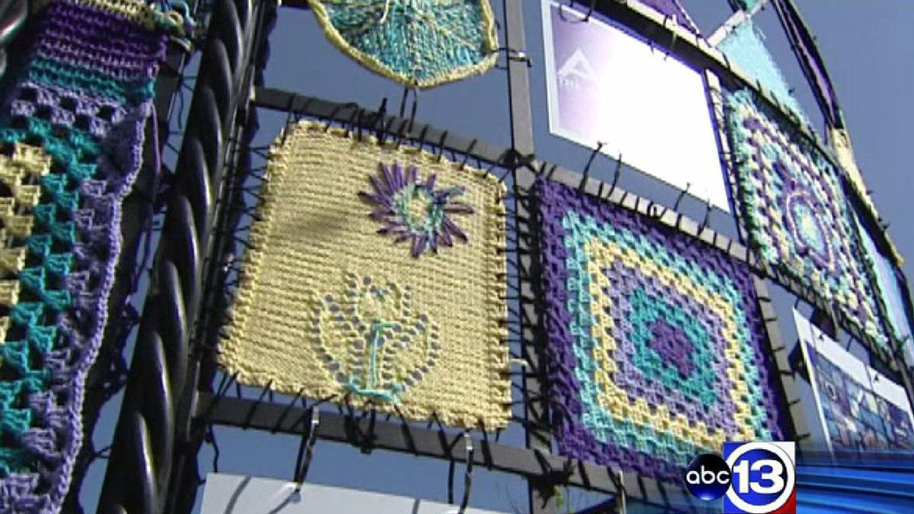 Yarn-bombing is a public art movement that involves covering anything with knitted and crocheted yarn creations. This installation is now up in The Heights, replacing one that was destroyed by a vandal.