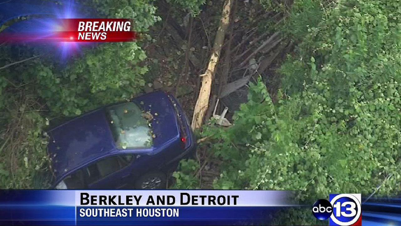 A car ran off the road, through some trees and down into a gully