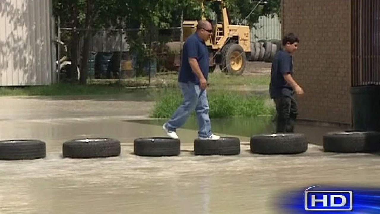 Tires used to cross flood waters from broken hydrant