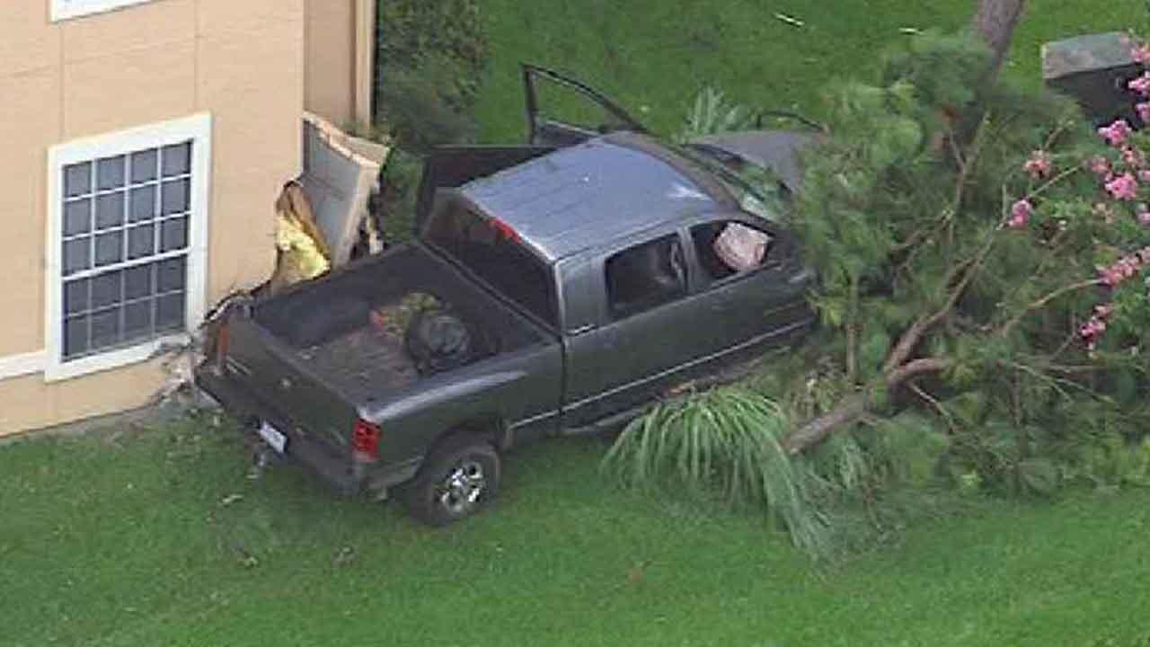 SkyEye13 HD was over the scene of a crash in northwest Harris County. This truck left the roadway and went through a fence before crashing into an apartment building
