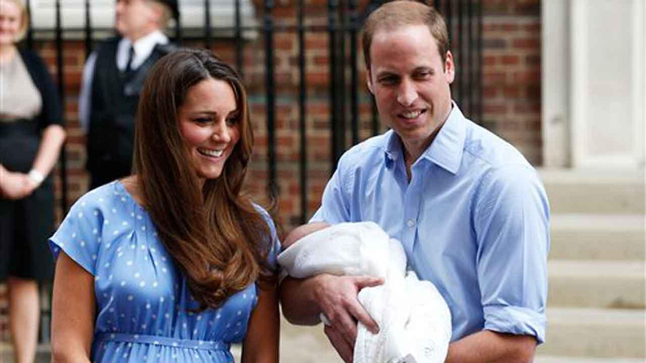 Britains Prince William and Kate, Duchess of Cambridge hold the Prince of Cambridge, Tuesday July 23, 2013, as they pose for photographers outside St. Marys Hospital exclusive Lindo Wing in London where the Duchess gave birth on Monday July 22. The Royal couple are expected to head to London???s Kensington Palace from the hospital with their newly born son, the third in line to the British throne.