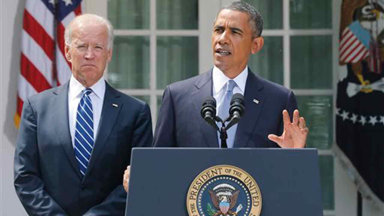 President Barack Obama stands with Vice President Joe Biden as he makes a statement about Syria in the Rose Garden at the White House in Washington, Saturday, Aug. 31, 2013