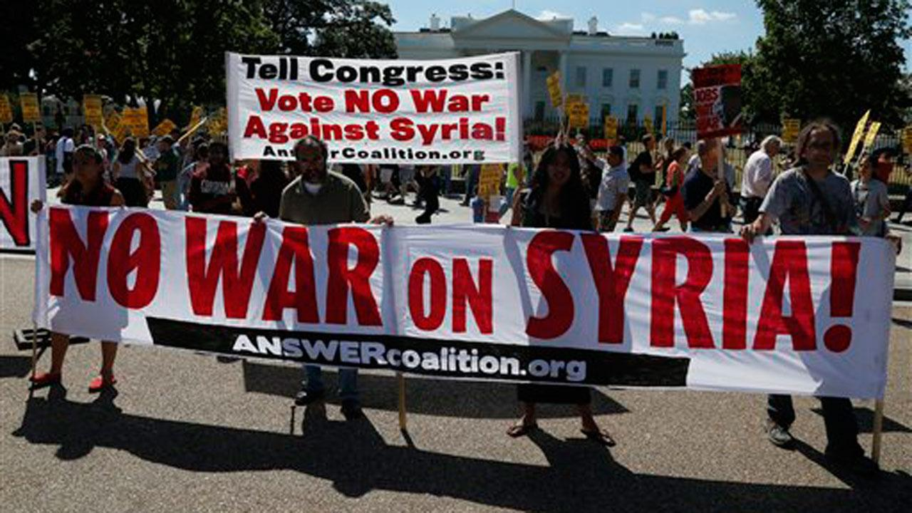 Anti-war demonstrators protest against possible U.S. military action in Syria in front of the White House in Washington, Saturday, Sept. 7, 2013