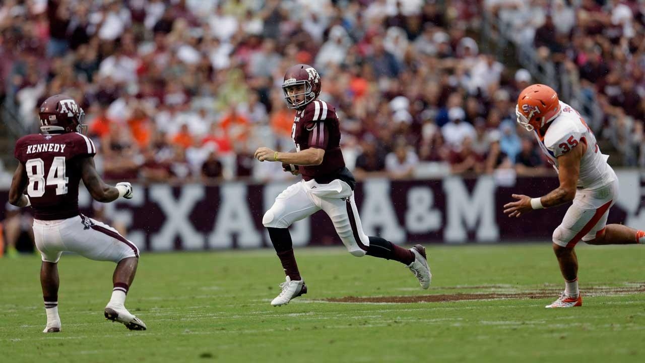 Texas A&M quarterback Johnny Manziel rushes for gain against Sam Houston State during the first quarter of an NCAA college football game Saturday, Sept. 7, 2013, in College Station, Texas. (AP Photo/David J. Phillip)