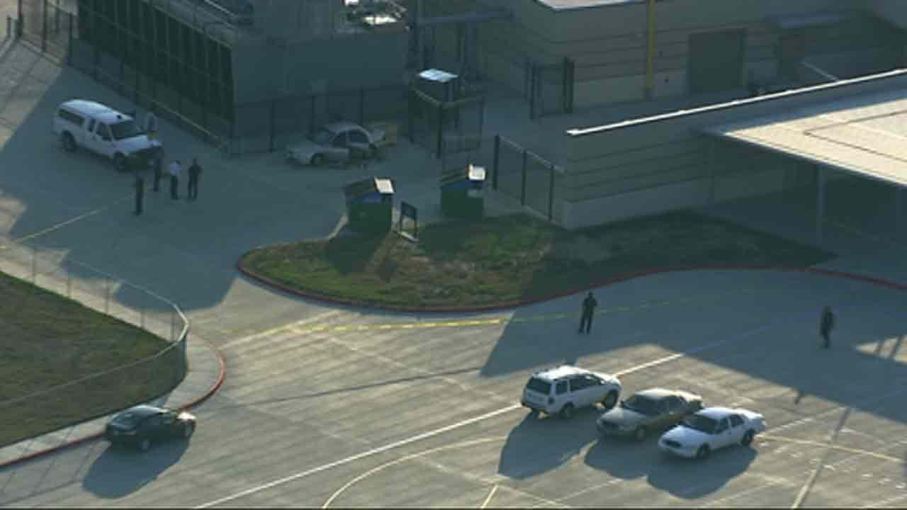Woman shot outside school
