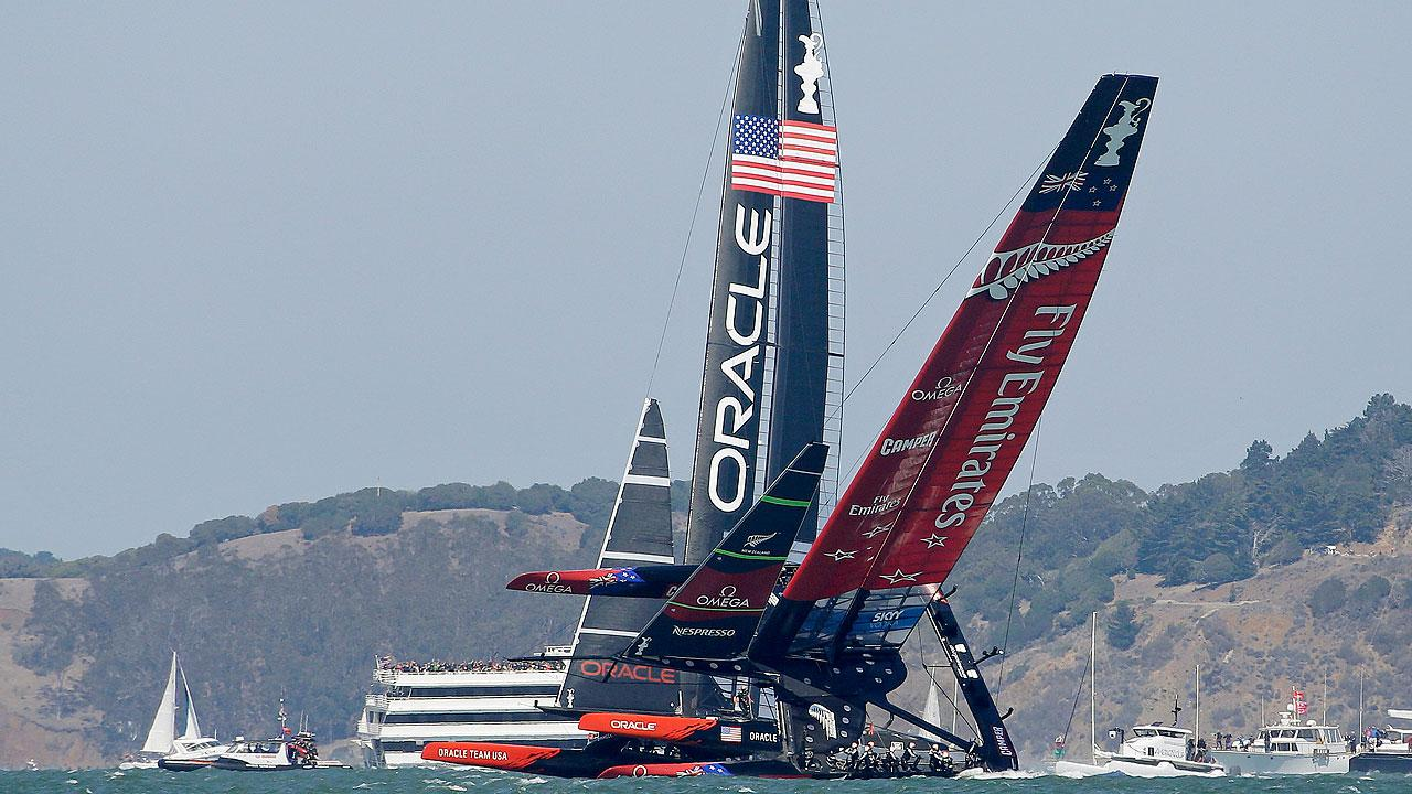 Emirates Team New Zealand nearly capsizes next to Oracle Team USA