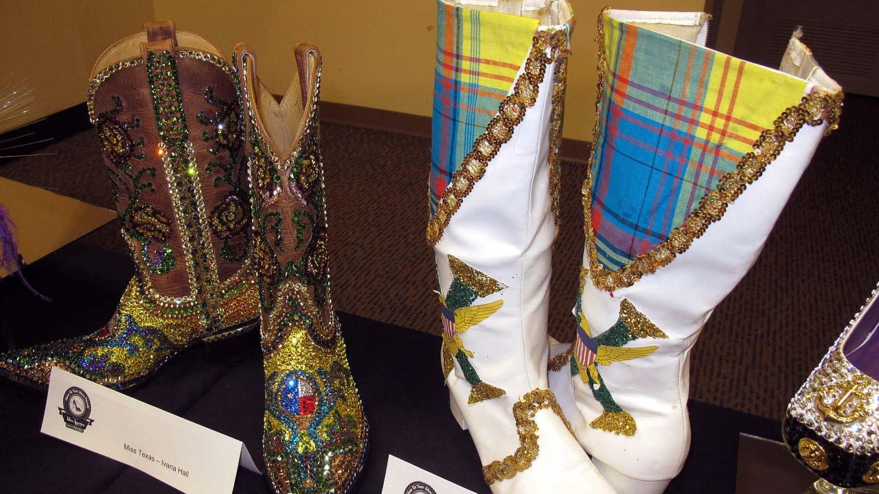This Sept. 10, 2013, photo shows decorated boots to be worn by contestants Miss Texas, left, and Miss Virgin Islands, in Saturdays show us your shoes parade, ahead of the Miss America in Atlantic City, N.J. (AP Photo/Wayne Parry)