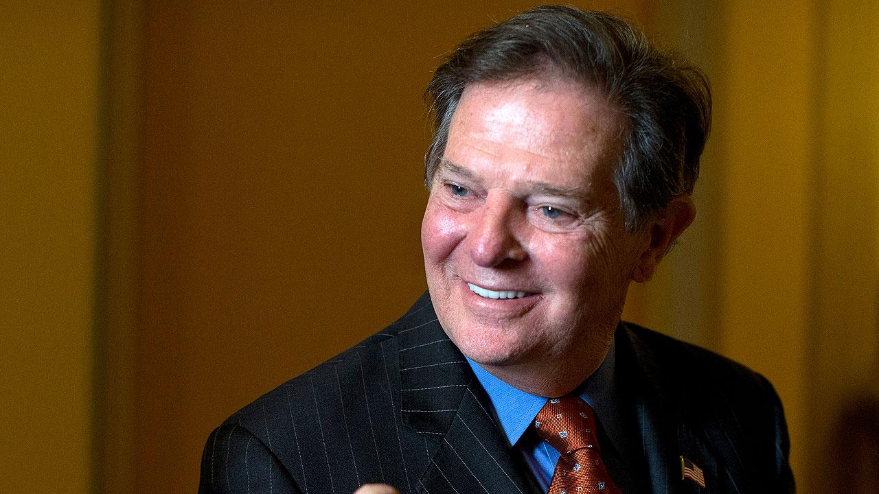 Former House Majority Leader Tom DeLay smiles as he leaves a lunch meeting on Capitol Hill
