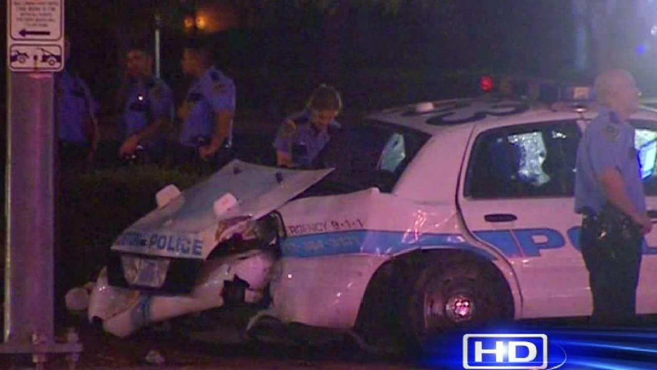 HPD officer injured, woman in custody being transported dies in wreck