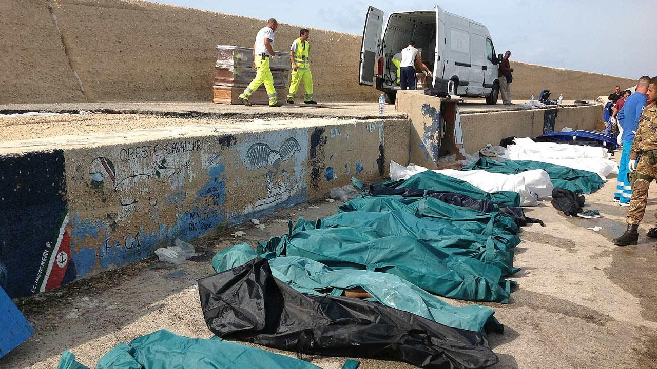 Bodies of drowned migrants are lined up in the port of Lampedusa