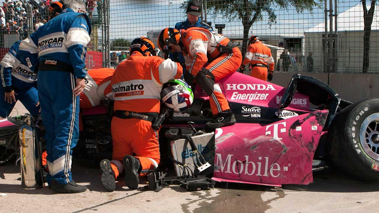 Dario Franchitti IndyCar crash at Grand Prix Houston sends fence debris flying into crowd, 15 injured