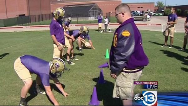 Football players embrace disabled teammate