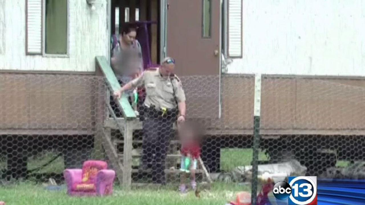 Deputies remove twin two-year-old girls from a Liberty County home where they were reportedly locked up, nude with no food