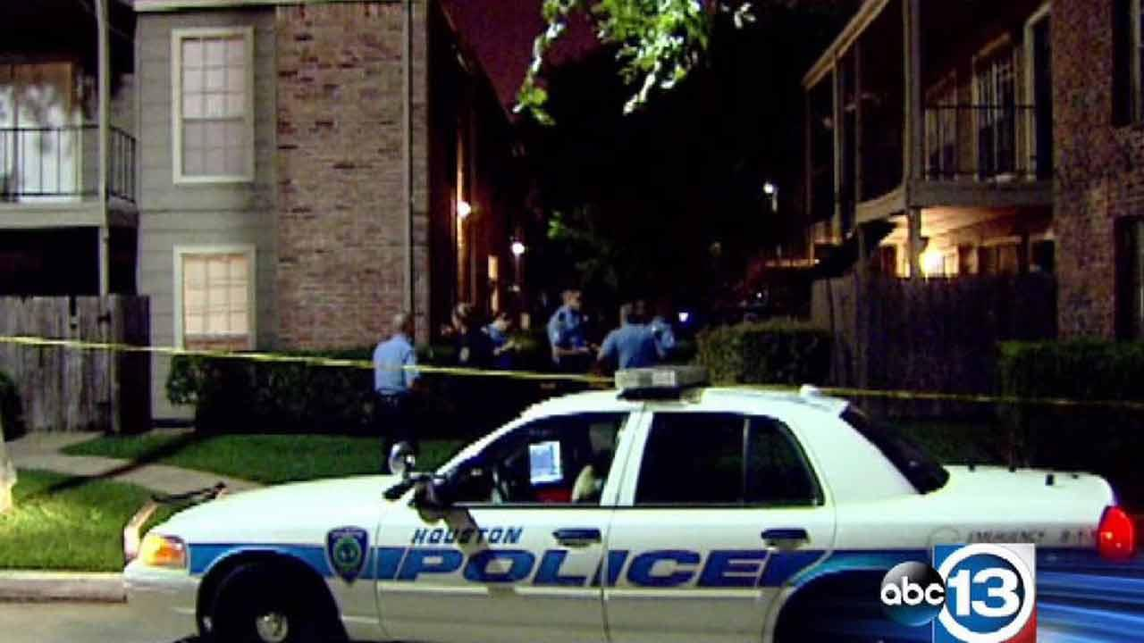 Houston police say a woman jumped from a second story window to escape from her ex-boyfriend, who officers say shot his way into an apartment.