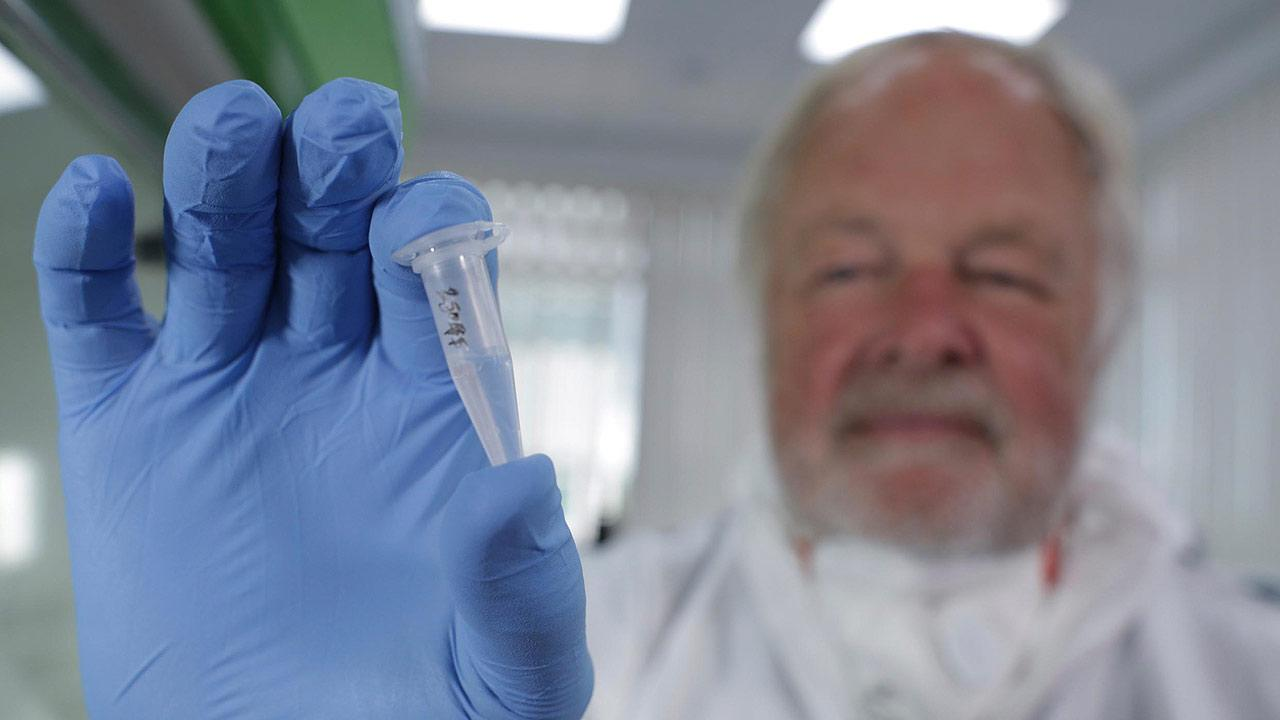 Oxford University genetics professor Bryan Sykes posing with a prepared DNA sample taken from hair from a Himalayan animal