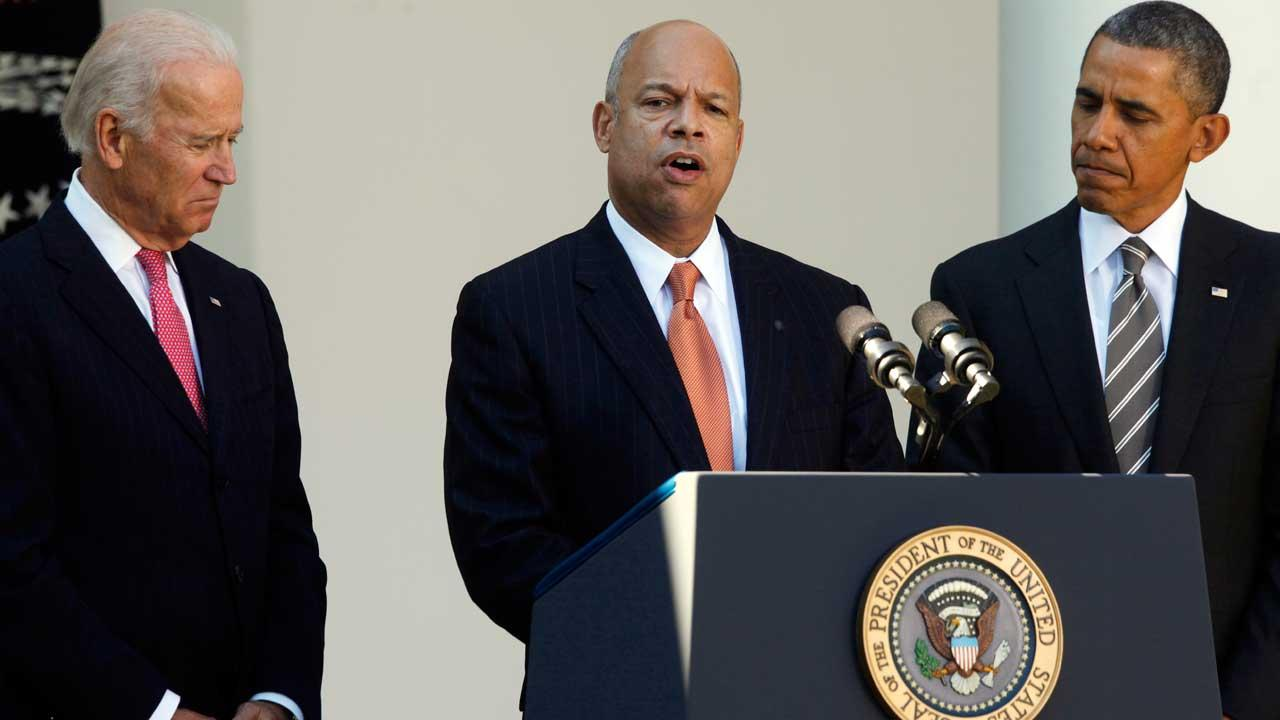 President Barack Obama stands with Jeh Johnson, his choice for the next Homeland Security Secretary, and Vice President Joe Biden, in the Rose Garden at the White House in Washington, Friday, Oct. 18, 2013. Johnson was general counsel at the Defense Department during the wars in Iraq and Afghanistan. (AP Photo/Charles Dharapak)
