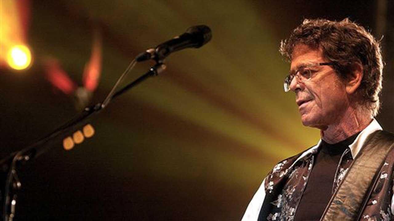 Lou Reed performs at the 13th Rock OzArenes Festival, in Avenches, Switzerland, Wednesday, Aug. 11, 2004