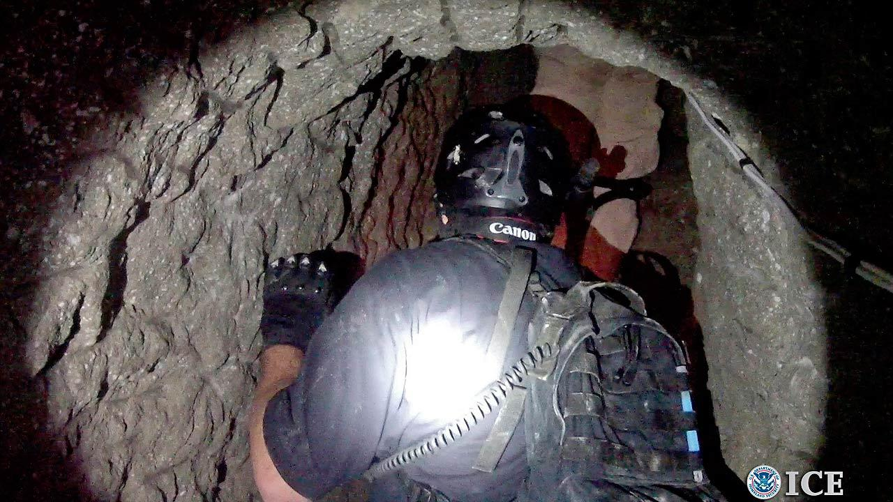 Agents in a tunnel designed to smuggle drugs