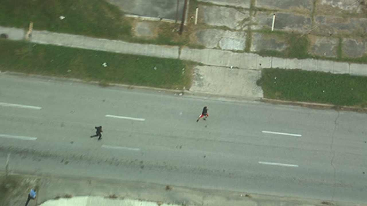 Police arrested two men, one of whom they chased down on foot, suspected of trying to rob a bank in west Houston