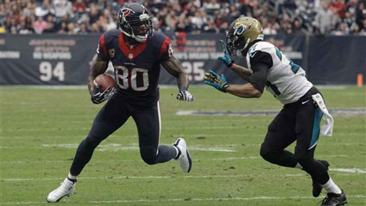 Houston Texans wide receiver Andre Johnson (80) is tackled by Jacksonville Jaguars cornerback Dwayne Gratz (27)
