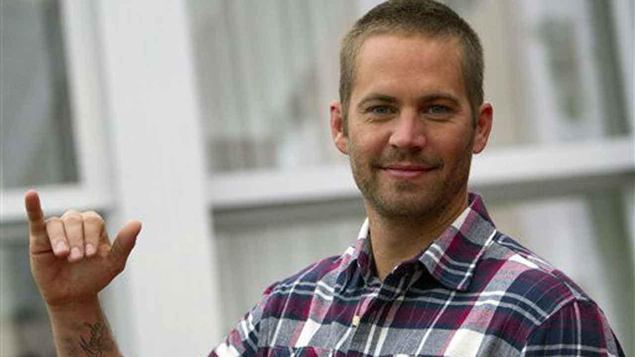 Actor Paul Walker poses during the photo call of the movie  Fast and Furious 5, in Rome Friday, April 29, 2011. (AP Photo/Andrew Medichini)