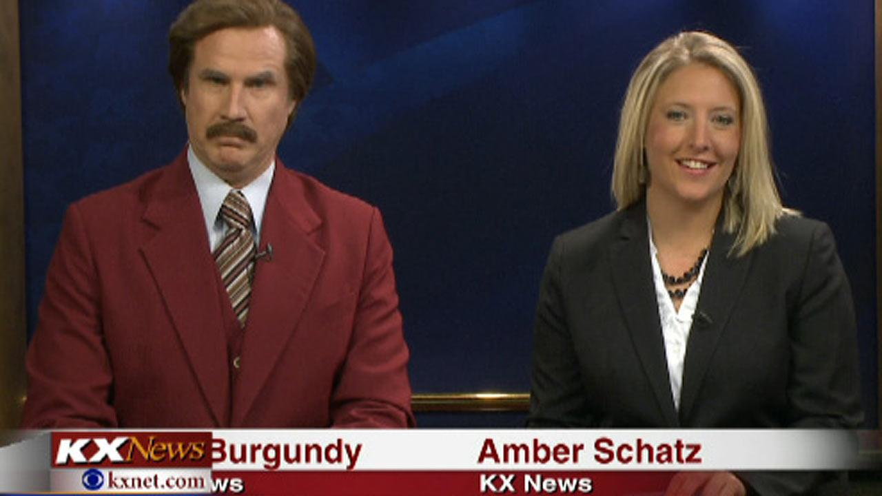 Will Ferrell, as his Anchorman character Ron Burgundy, co-anchors the evening news with Amber Schatz