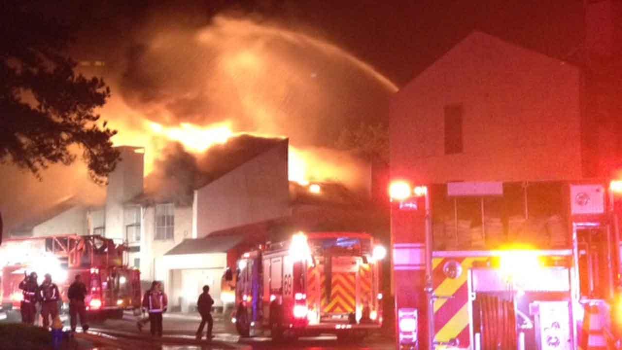 Firefighters battle a two-alarm blaze on Ella Lee Road in west Houston