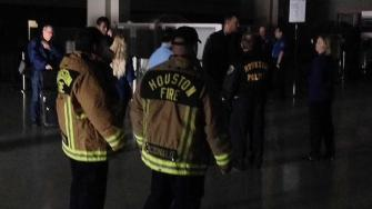 Houston firefighters stand in a dark Terminal B at Houstons Bush Airport