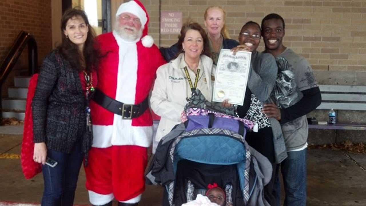 Chaplain Virginia Howell and Santa Claus pose with the newlyweds outside the Harris County Sheriffs Office dispatch center in downtown Houston.