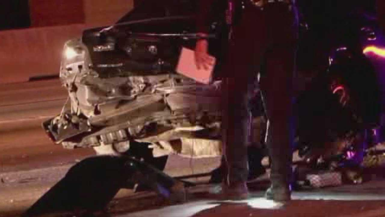 A mangled vehicle is seen after a crash blamed on a high-speed chase in north Harris County