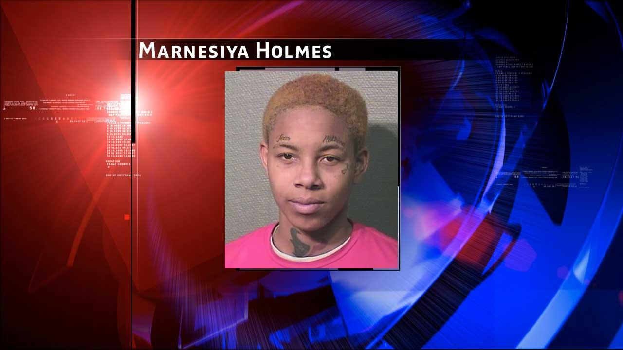 Marnesiya Holmes, 20, was charged with misdemeanor assault on a family member and felony reckless injury to a child