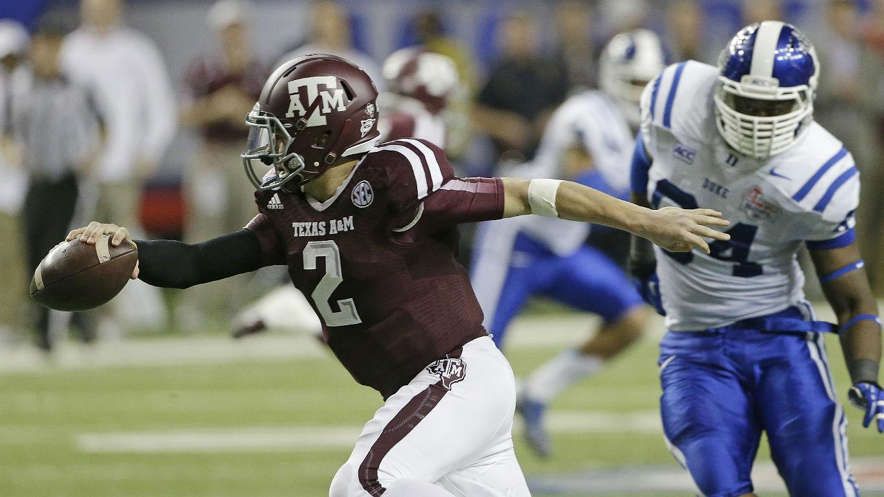 Texas A&M quarterback Johnny Manziel (2) is chased by Duke linebacker C.J. France (54) in the second half of the Chick-fil-A Bowl