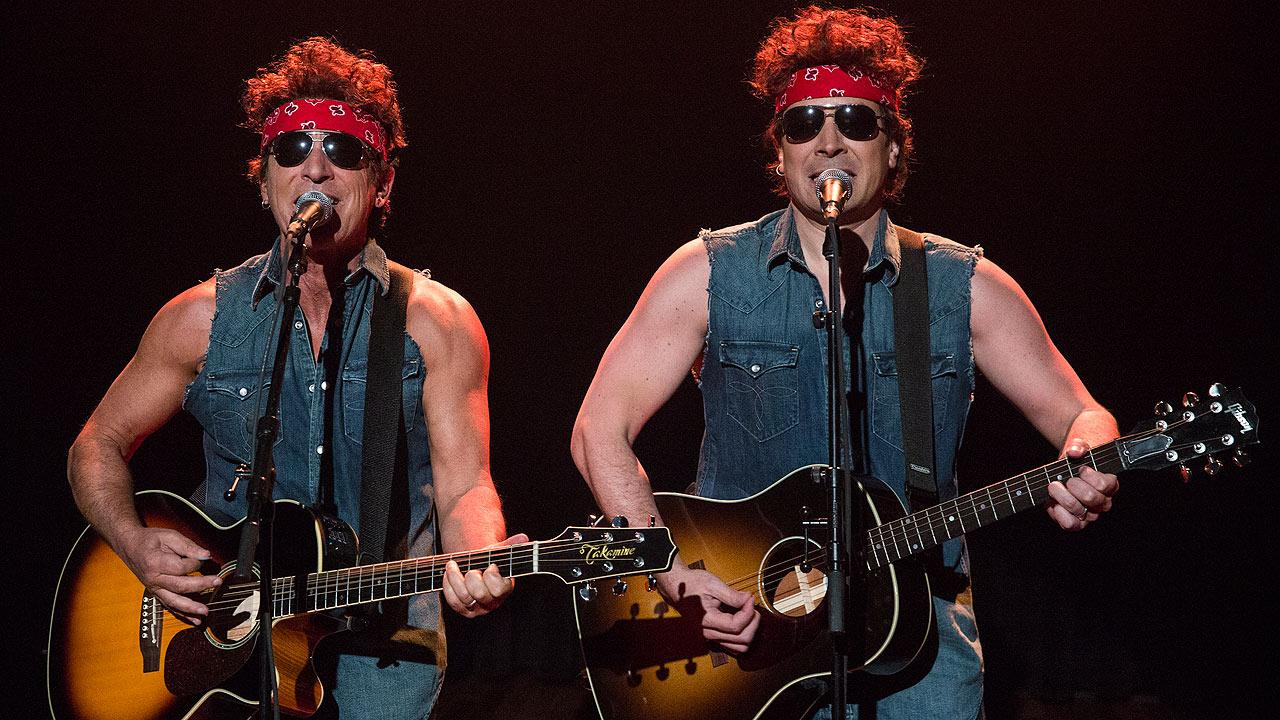 This image released by NBC shows Bruce Springsteen, left, and Jimmy Fallon performing during Late Night with Jimmy Fallon