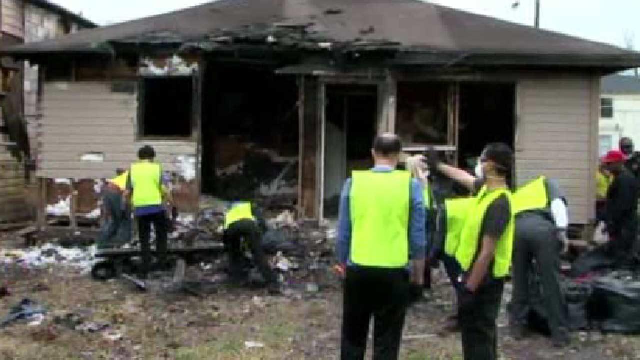 Volunteers help clear burned home