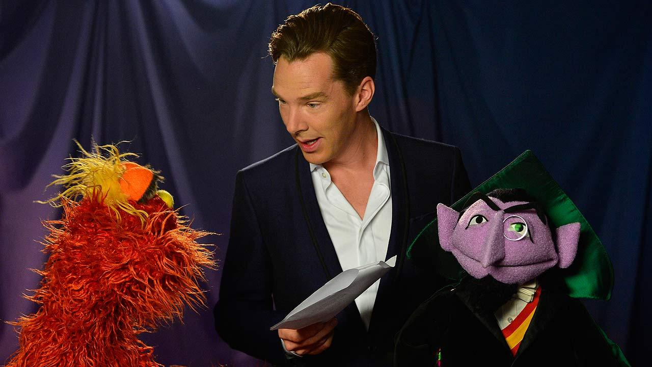 This image released by PBS shows Sesame Street characters Murray Monster, left, and Count von Count, right, with actor Benedict Cumberbatch