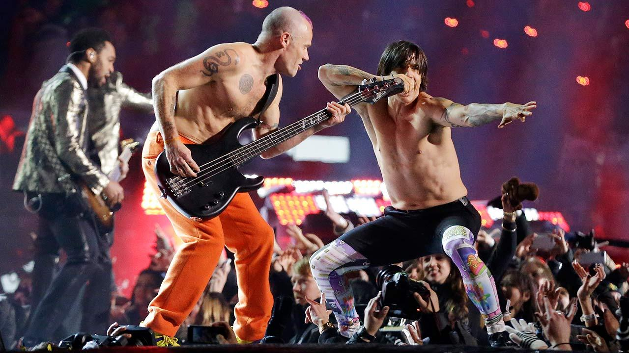 The Red Hot Chili Peppers band members Flea, center, and Anthony Kiedis perform during the halftime show of the NFL Super Bowl XLVIII