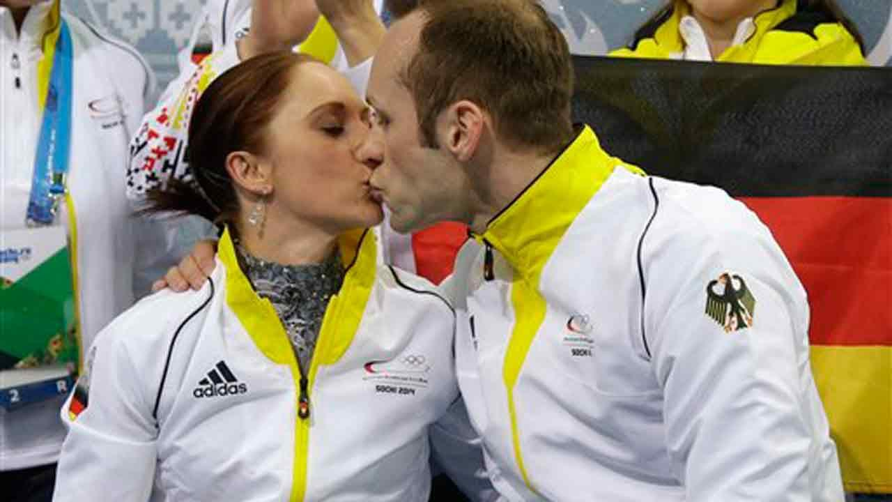 Maylin Wende and Daniel Wende of Germany kiss as they wait for their results after competing in the team pairs short program figure skating competition at the Iceberg Skating Palace during the 2014 Winter Olympics