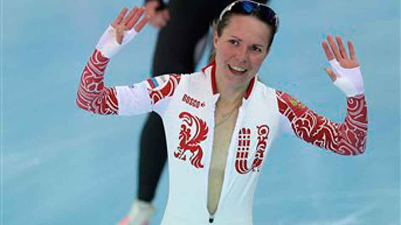 Bronze medallist Olga Graf of Russia celebrates with a wide open front of her skin suit after the womens 3,000-meter speedskating race at the Adler Arena Skating Center during the 2014 Winter Olympics